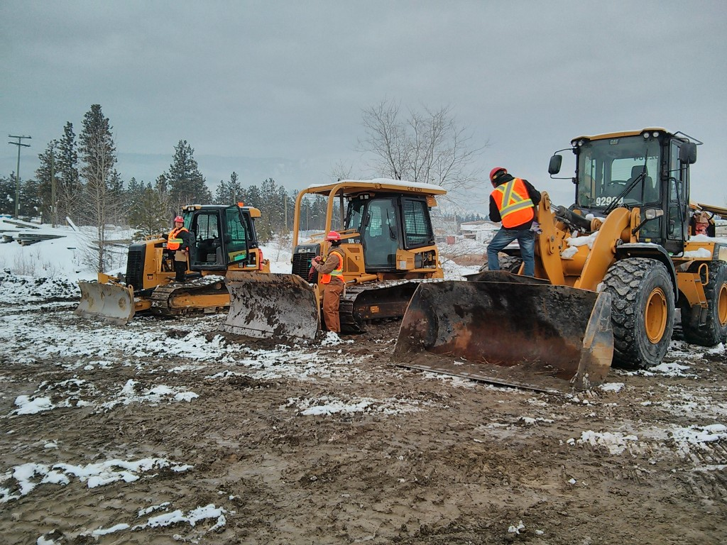 Students on dozers and loader